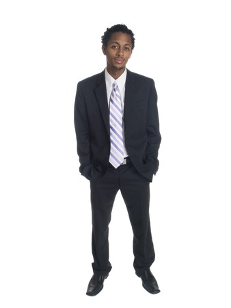 Isolated full length studio shot of a relaxed and confident businessman smiling at the camera. photo