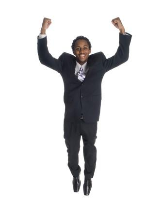 Colpo di studio isolata di un imprenditore di salti di gioia con il pugno stretto.  Archivio Fotografico - 8081030