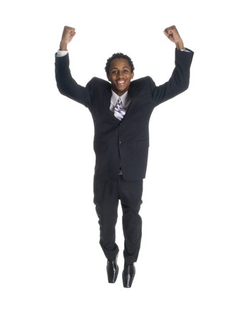 Isolated studio shot of a businessman jumping for joy with clenched fists.