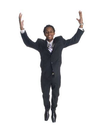 african business man: Isolated studio shot of a businessman jumping for joy.