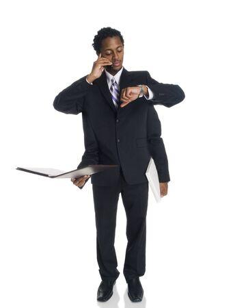 gestion del tiempo: Disparo de estudio aislado de un empresario de multitarea con cuatro brazos.