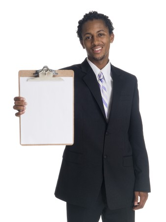 Isolated studio shot of a smiling businessman presenting a clipboard. photo