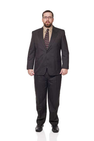 Isolated full length studio shot of the front view of a businessman in full suit looking at the camera. Stock Photo - 8081716