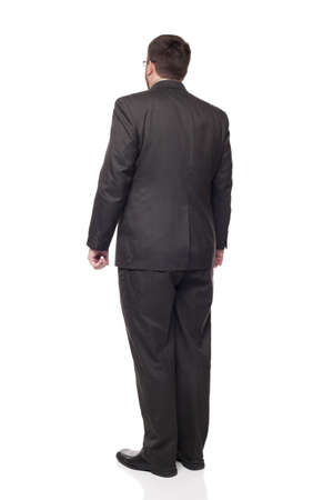 looking away from camera: Isolated full length studio shot of the rear view of a businessman in full suit looking away from the camera.