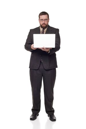 Isolated full length studio shot of a businessman with a wide eyed expression looking at a laptop as if he can't believe what he is seeing. Stock Photo - 8081206
