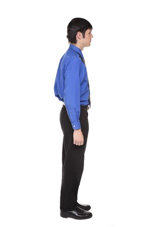facing away: Isolated full length studio shot of the side view of a Caucasian businessman standing with arms at sides and looking away to the right.