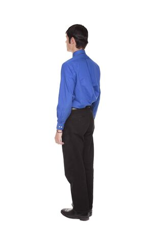 facing away: Isolated full length studio shot of the rear view of a Caucasian businessman standing with arms at sides and looking away to the left.