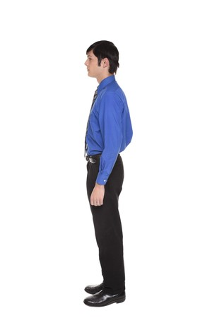 Isolated full length studio shot of the side view of a Caucasian businessman standing with arms at sides and looking away to the left