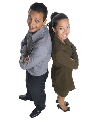 Isolated high angle studio shot of a businessman and businesswoman standing back to back. Stock Photo - 8081329