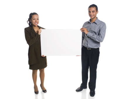 Isolated studio shot of a businessman and businesswoman holding a blank sign. Stock Photo - 8081094