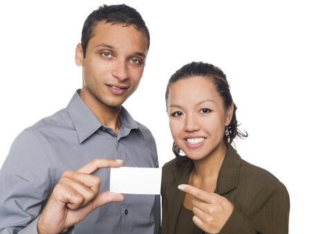 Isolated studio shot of a businessman and businesswoman displaying a business card and pointing at it. photo