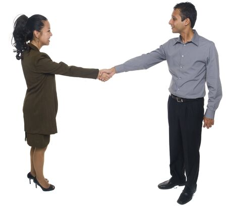 Isolated studio shot of businesspeople shaking hands and greeting each other. Stock Photo - 8081404
