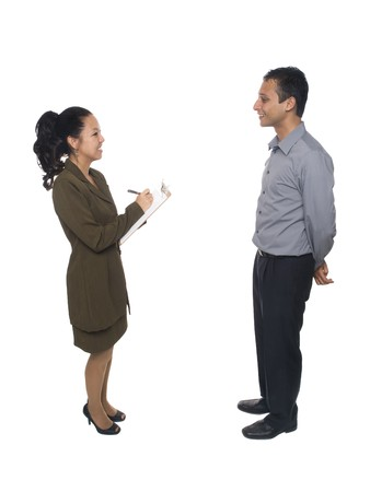 Isolated studio shot of a businessman and businesswoman filling out information on a clipboard during an interview Stock Photo - 8081136