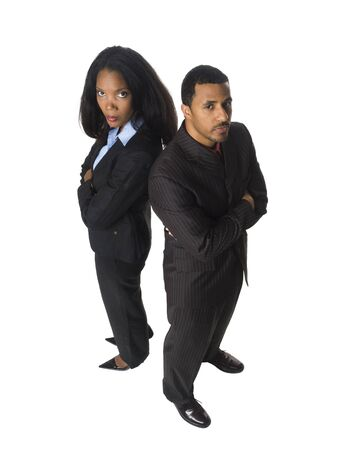 Isloated studio shot of an African American business team looking at the camera with a serious expression. Stock Photo - 8081229