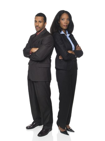 african business man: Isloated studio shot of an African American business team looking at the camera with a serious expression.