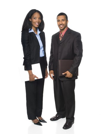 Isolated full length studio shot of a businesswoman and businessman smiling at the camera and holding a computer and organizer. photo