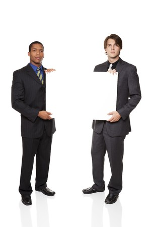 Isolated full length studio shot of two businessmen presenting a blank sign ready for your copy. photo
