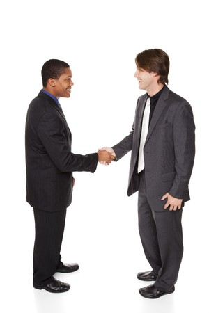 african american handshake: Isolated studio shot of two businessmen shaking hands in a warm, friendly greeting.