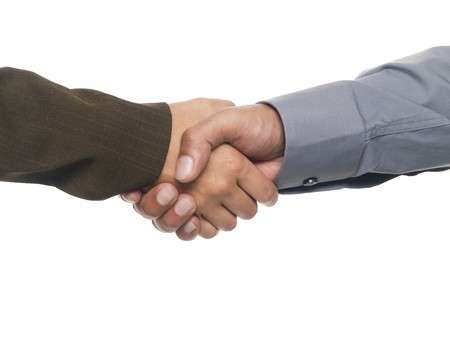 Isolated studio shot of a businessman and businesswoman shaking hands Stock Photo - 8050833