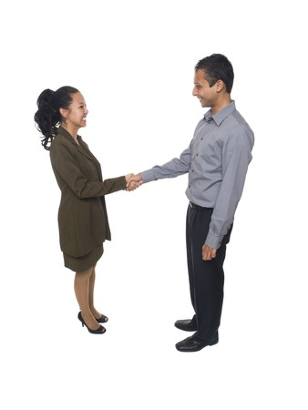 greeting people: Isolated full length studio shot of a businessman and businesswoman shaking hands.