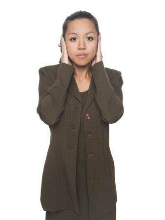 Isolated studio shot of a businesswoman in the Hear No Evil pose. Stock Photo - 8081382