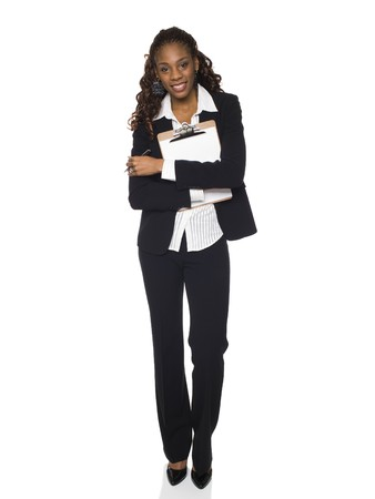 dgf15: Stock photo of an African American businesswoman smiling at the camera while holding a clipboard to her chest.