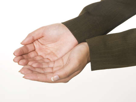 Isolated studio shot of a businesswoman's cupped hands. Stock Photo - 8047164