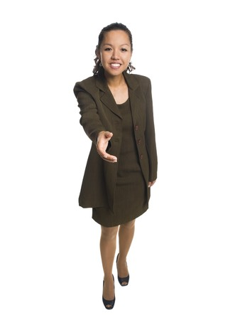 Isolated full length studio shot of a businesswoman  reaching out to shake hands with the camera Stock Photo - 8081070