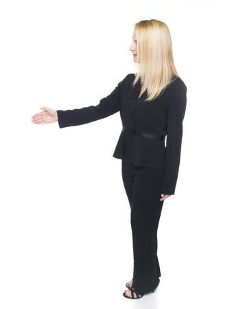 pantsuit: Isolated studio shot of a blonde businesswoman reaching out to shake hands