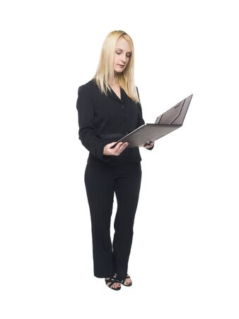 pantsuit: Isolated studio shot of a businesswoman reviewing notes in her notebook.
