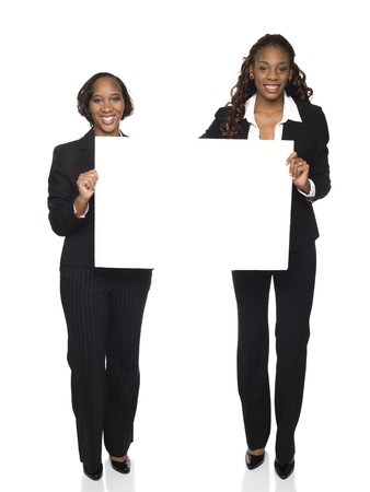 Isolated studio shot of two businesswomen holding a big blank sign. Banque d'images