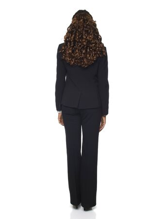 pantsuit: Isolated studio shot of the back side of a businesswoman.