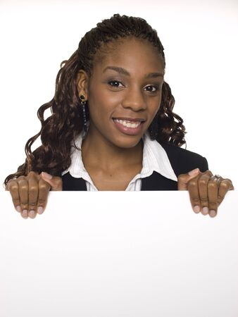 business sign: Isolated studio shot of a businesswoman holding a big blank sign. Stock Photo