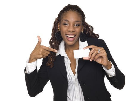 Isolated studio shot of an ecstatic businesswoman pointing happily at her brand new business card while grining. Foto de archivo