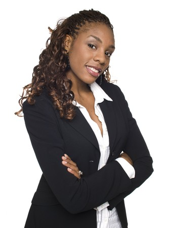 african american woman business: Isolated studio shot of a confident businesswoman looking at the camera with her arms crossed.