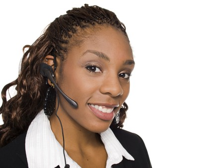 black secretary: Isolated studio shot of a smiling businesswoman talking on a customer service telephone headset. Stock Photo