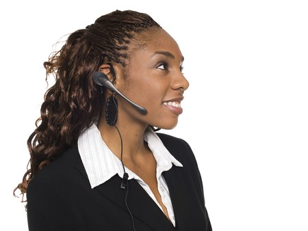 dgf15: Isolated studio shot of a smiling businesswoman talking on a customer service telephone headset. Stock Photo