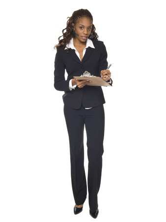 questionaire: Isolated studio shot of a businesswoman wearing a headset telephone and writing on a clipboard.