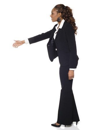 Isolated studio shot of a businesswoman reaching out to shake hands. photo