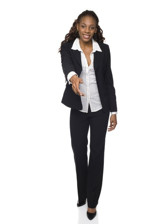 pantsuit: Isolated studio shot of a businesswoman reaching out to shake hands. Stock Photo