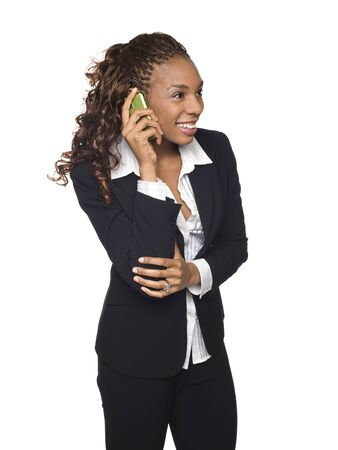 dgf15: Isolated studio shot of a businesswoman talking on her cellphone. Stock Photo