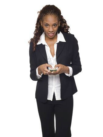 Isolated studio shot of a businesswoman sending text messages from her cell phone. photo