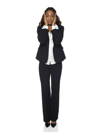 dgf15: Isolated studio shot of a businesswoman in the Hear No Evil pose.