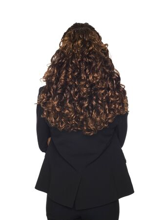Isolated studio shot of a businesswomans pretty hair viewed from behind photo