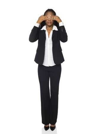 dgf15: Isolated studio shot of a businesswoman in the See No Evil pose.