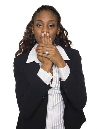 dgf15: Isolated studio shot of a businesswoman in the Speak No Evil pose.