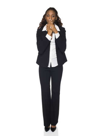 pantsuit: Isolated studio shot of a businesswoman in the Speak No Evil pose.