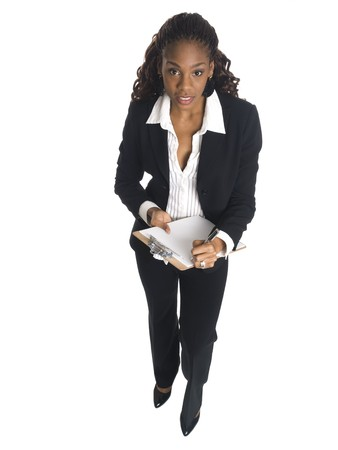 dgf15: Isolated high angle studio shot of a businesswoman writing on a clipboard. Stock Photo