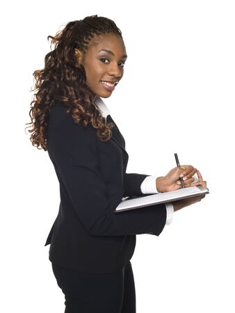 Isolated studio shot of a businesswoman writing on a notepad. Stock Photo - 8081295