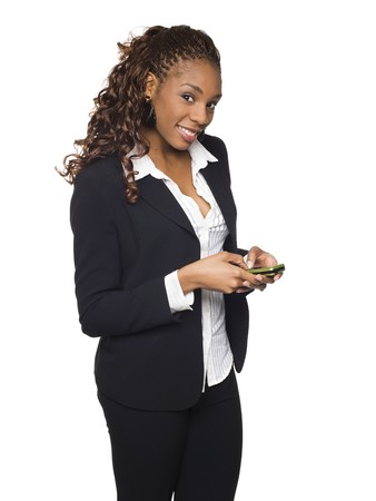 dgf15: Isolated studio shot of a businesswoman sending text messages from her cell phone. Stock Photo